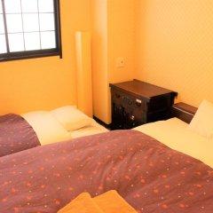 Отель K's House Tokyo Oasis Кровать в общем номере фото 10