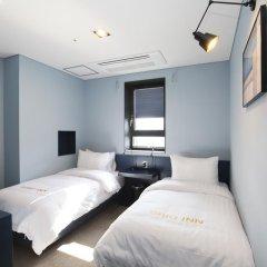 Отель Grid Inn 2* Стандартный номер с 2 отдельными кроватями фото 2