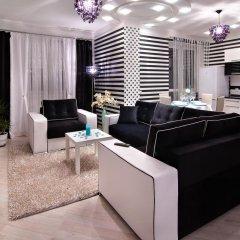 Апартаменты EuApartments в центре города комната для гостей фото 5