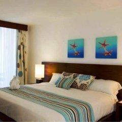 Отель Grand Paradise Playa Dorada - All Inclusive 3* Улучшенный номер с различными типами кроватей фото 9