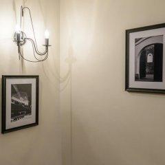 Отель Mikalojaus apartamentai сейф в номере