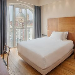 Отель NH Torino Santo Stefano 4* Стандартный номер с различными типами кроватей фото 2