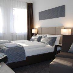 Dom Hotel Am Römerbrunnen 3* Номер Делюкс с различными типами кроватей фото 6
