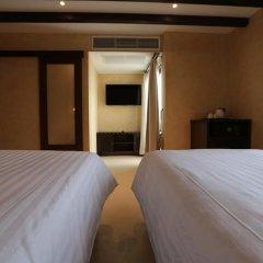 Отель Dewan Bangkok 3* Улучшенный номер с различными типами кроватей фото 6