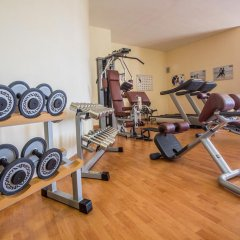Отель Sangiorgio Resort & Spa Кутрофьяно фитнесс-зал