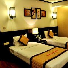 Muong Thanh Three Star Hotel 3* Номер Делюкс фото 4