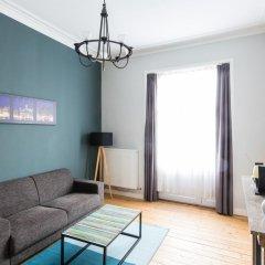 Отель Urban Suites Brussels EU Улучшенные апартаменты с различными типами кроватей