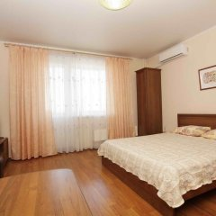 Апартаменты Альт Апартаменты (40 лет Победы 29-Б) Стандартный семейный номер с разными типами кроватей фото 10