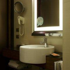 Отель NH Milano Touring 4* Стандартный номер разные типы кроватей фото 6