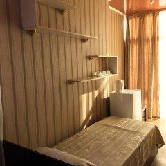 Гостиница Сафари Улучшенный семейный номер с разными типами кроватей фото 4