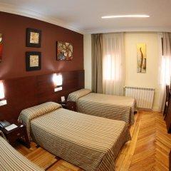 Отель Hostal Abadia Стандартный номер с 2 отдельными кроватями фото 11