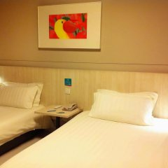 Отель Jinjiang Inn (Huangpu Avenue Bridge) 2* Стандартный номер с 2 отдельными кроватями фото 2