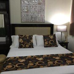 Отель MCH Suites at Le Mirage de Malate Филиппины, Манила - отзывы, цены и фото номеров - забронировать отель MCH Suites at Le Mirage de Malate онлайн комната для гостей фото 3