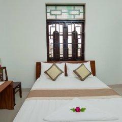 Отель Tra Que Flower Homestay Стандартный номер с двуспальной кроватью фото 6