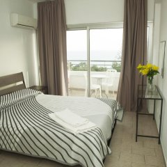Апартаменты Anemos Apartments комната для гостей фото 5