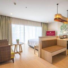 Отель Ramada by Wyndham Phuket Deevana Patong Номер Делюкс с двуспальной кроватью фото 7
