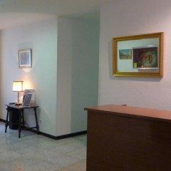 Отель Hostal Americano удобства в номере