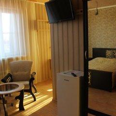 Гостиница Сафари Улучшенный семейный номер с разными типами кроватей фото 2