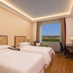 Отель Four Points by Sheraton New Delhi, Airport Highway 4* Номер Комфорт с различными типами кроватей фото 6