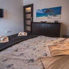 Отель Apartamenty Sun & Snow Pardałówka Закопане комната для гостей фото 2