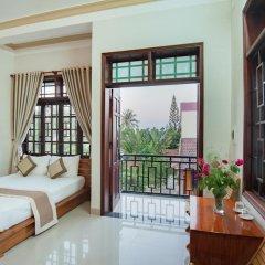 Отель Tra Que Flower Homestay Стандартный номер с двуспальной кроватью фото 12