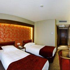 Отель Bella Стандартный номер с двуспальной кроватью фото 10
