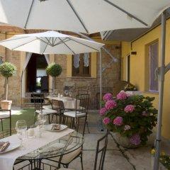 Отель Locanda Il Cortile Виньяле-Монферрато питание