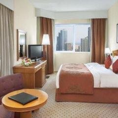 Отель Golden Tulip Sharjah Представительский люкс с различными типами кроватей фото 10
