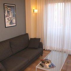 Отель Apartaments Suites Independencia Испания, Барселона - 2 отзыва об отеле, цены и фото номеров - забронировать отель Apartaments Suites Independencia онлайн комната для гостей фото 5