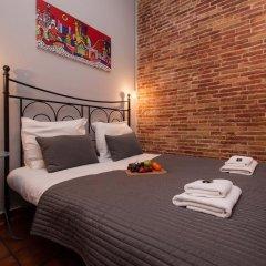 Апартаменты Plaza Real Apartments Барселона комната для гостей фото 5