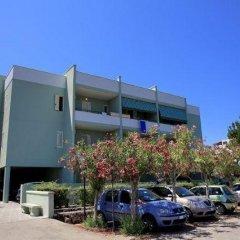 Отель Bilocali Baia Verde парковка