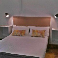 Frenteabastos Hostel & Suites Стандартный семейный номер с двуспальной кроватью