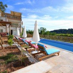 Villa Kelebek Oz Турция, Патара - отзывы, цены и фото номеров - забронировать отель Villa Kelebek Oz онлайн бассейн фото 3