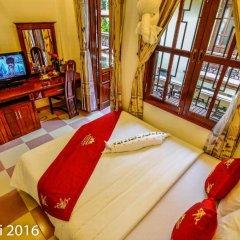 Отель Nhi Nhi 3* Номер Делюкс фото 5