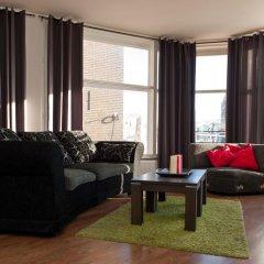 Отель Old City Centre apartments - Damrak building Нидерланды, Амстердам - отзывы, цены и фото номеров - забронировать отель Old City Centre apartments - Damrak building онлайн комната для гостей