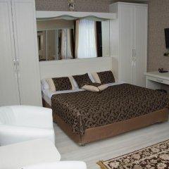 Мини-Отель Каприз комната для гостей фото 4