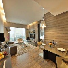 Отель Pan Pacific Serviced Suites Beach Road, Singapore комната для гостей фото 4