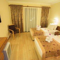 Отель Liberty Hotels Oludeniz 4* Стандартный семейный номер с двуспальной кроватью фото 3