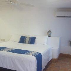 Отель Playa Conchas Chinas 3* Стандартный номер фото 11