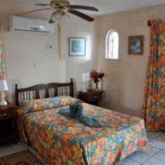 Апартаменты Carib Beach Apartments Negril комната для гостей фото 4