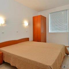 Апартаменты ПМГ Апартаменты Лагуна Солнечный берег комната для гостей