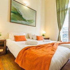 Отель Flores 105 Лиссабон комната для гостей фото 5