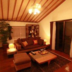 Отель Cottage Hakuraku Центр Окинавы комната для гостей фото 3