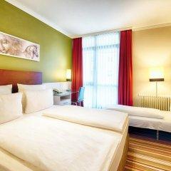 Отель Leonardo Hotel & Residenz München Германия, Мюнхен - 11 отзывов об отеле, цены и фото номеров - забронировать отель Leonardo Hotel & Residenz München онлайн комната для гостей фото 3
