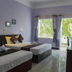 Отель The Moon Villa Hoi An 2* Стандартный семейный номер с различными типами кроватей фото 22