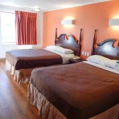 Отель Budget Inn Columbus West Стандартный номер с различными типами кроватей