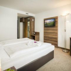 Отель Arthotel ANA Enzian 3* Стандартный номер с различными типами кроватей фото 6
