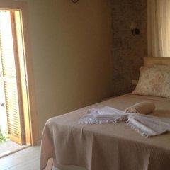 Отель Köşem Konukevi Чешме комната для гостей фото 3