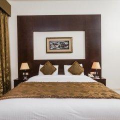 Отель Arabian Dreams Deluxe Hotel Apartments ОАЭ, Дубай - отзывы, цены и фото номеров - забронировать отель Arabian Dreams Deluxe Hotel Apartments онлайн комната для гостей фото 2