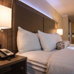 Отель GEC Granville Suites Downtown сейф в номере